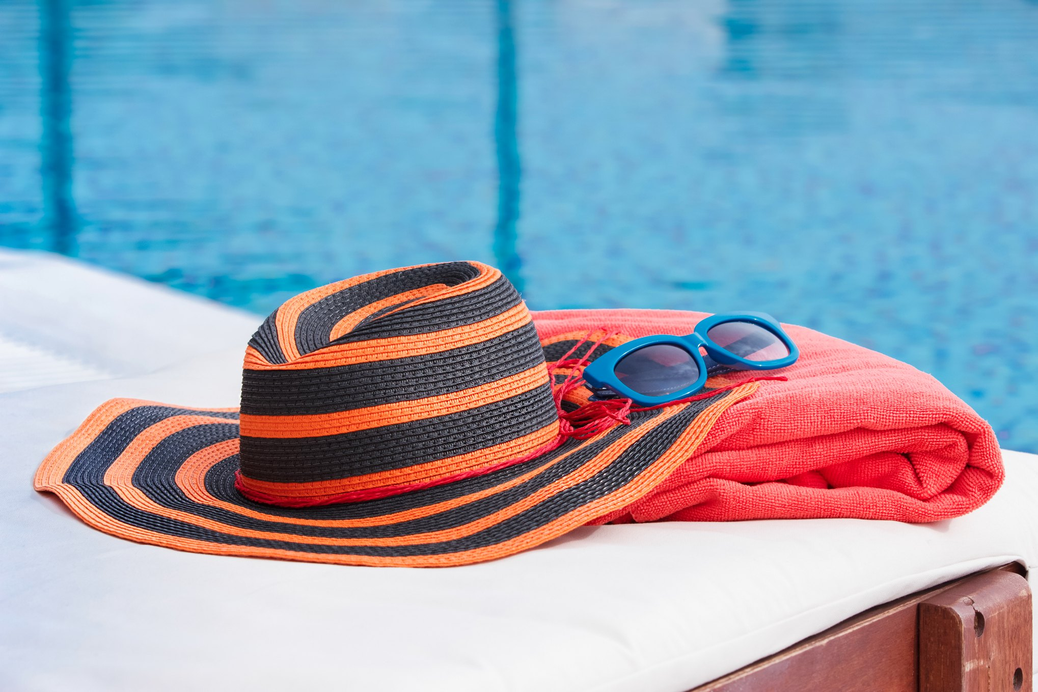POOL SIDE WITH TOWEL AND A HAT