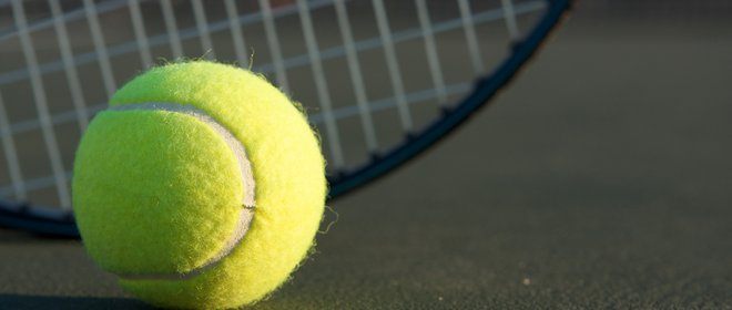 Tennis Ball with Racket in the background